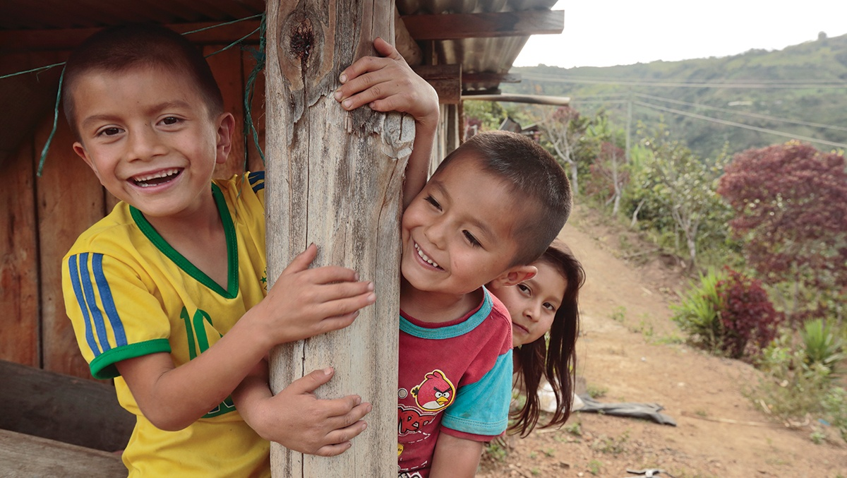 Fidencio's son Aldair, with cousins Juan David and Dania, outside Fidencio's house in Colombia. Photo by Oscar Leiva/Silverlight for CRS