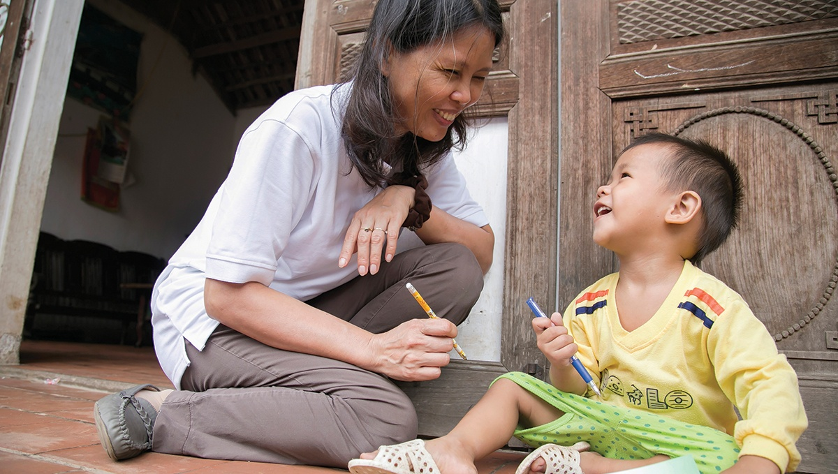 Ngoc is unable to walk, talk or control her muscle movements. As a result of CRS' collaboration with local government to provide home-based educational opportunities, she now lives a healthier life. Photo by Jennifer Hardy/CRS